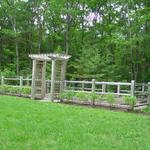 Vegetable garden enclosure - rustic fence with arbor