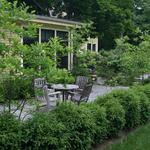 Mature plantings surround this cozy eating area.