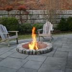 Cobblestone (Belgian Block) fire pit set into a multiple pattern bluestone patio