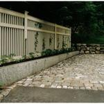 Antique Cobblestone (Belgian Block) parking area  with granite curbing retaining wall