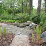 New England Fieldstone defines this rustic sitting area